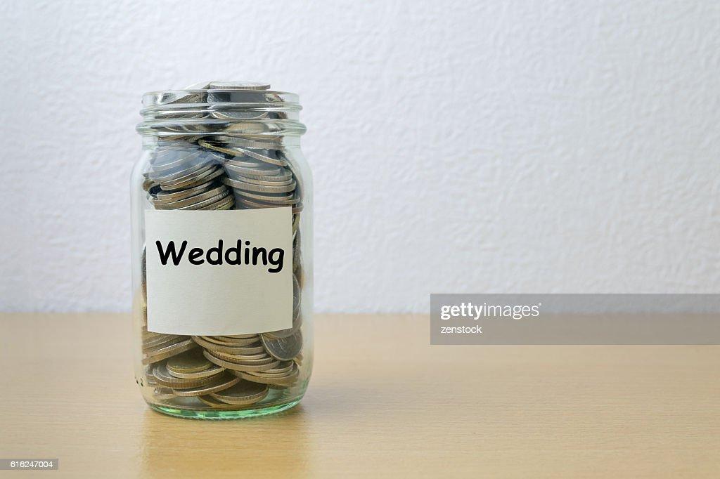 Money saving for Wedding in the glass bottle : Stock Photo