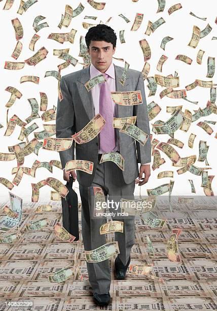 Money shower on a businessman