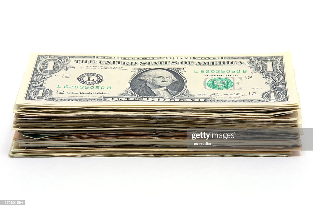 Money stacked up with a one dollar bill on top : Stock Photo
