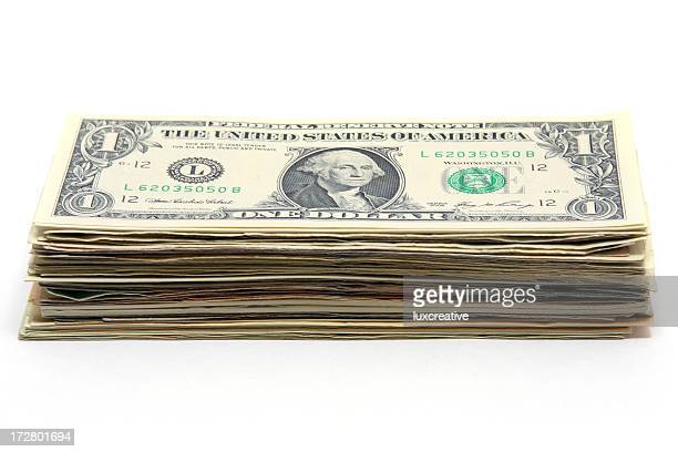 money stacked up with a one dollar bill on top - us dollar note stock photos and pictures