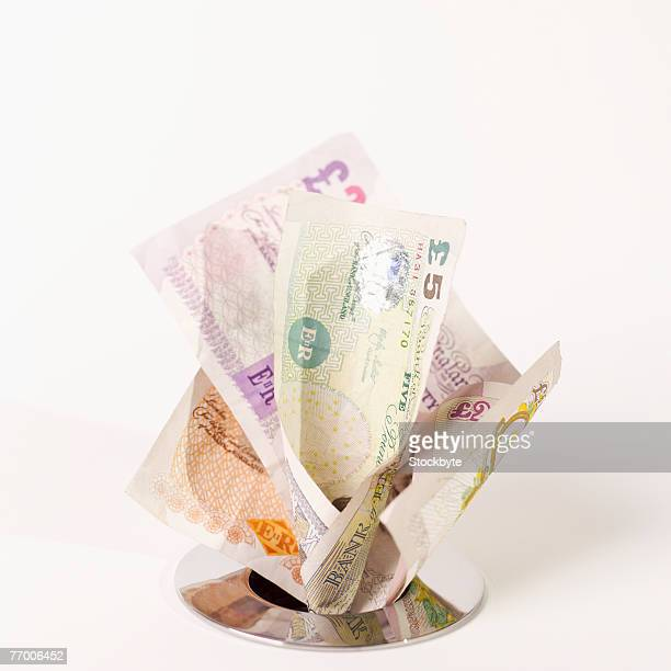 Money stuffed into drain