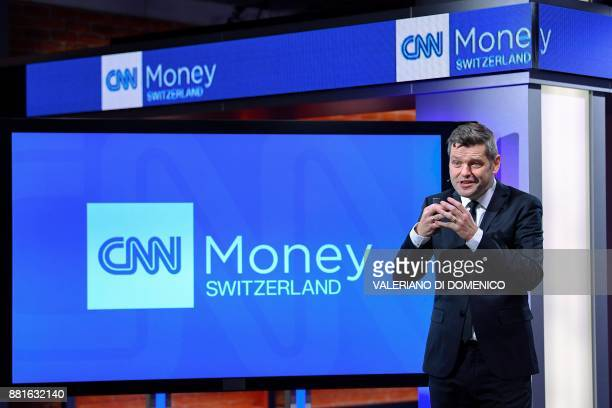 CNN Money Switzerland editorinchief Urs Gredig talks during a press conference at their studios in Zurich on November 29 2017 The Englishlanguage...