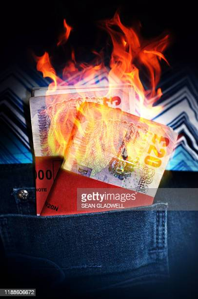 money to burn - burning stock pictures, royalty-free photos & images