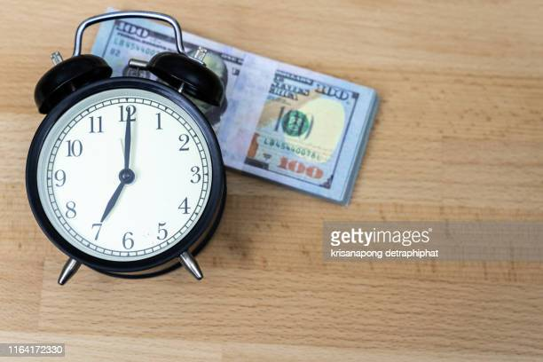 money with the clock - clocks go forward stock pictures, royalty-free photos & images