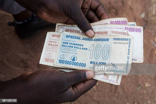 A moneychanger at the Chirundu border post between Zambia and Zimbabwe displays some of the older high denomination banknotes from Zimbabwe that now...