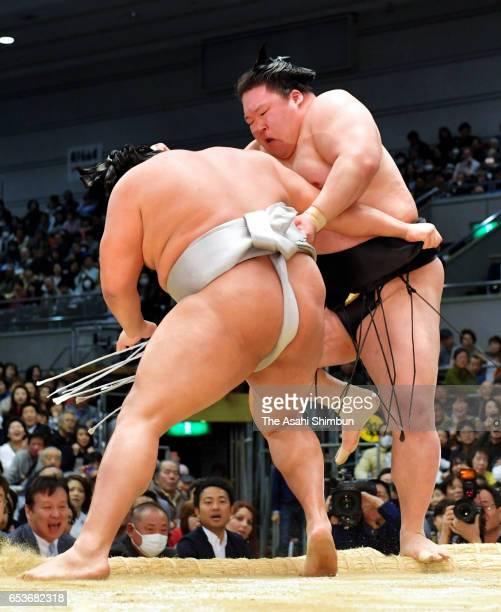 Mongaolian Takanoiwa pushes Ozeki Goeido to win during day four of the Grand Sumo Spring Tournament at Edion Arena Osaka on March 15 2017 in Osaka...