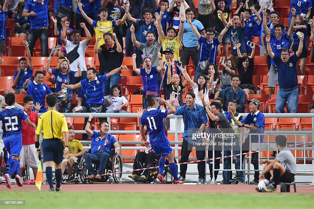 Mongkol Tossakrai #11 of Thailand celebrates his goal during the 2018 FIFA World Cup Qualifier match between Thailand and Iraq at Rajamangala Stadium on September 8, 2015 in Bangkok, Thailand.