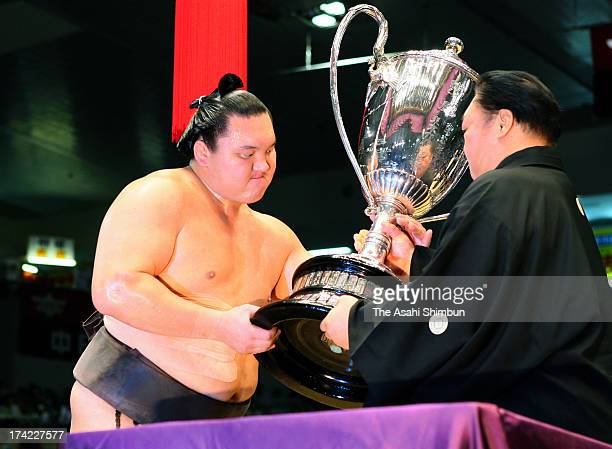 Monglian yokozuna Hakuho whose real name is Mnkhbatyn Davaajargal receives the trophy after winning the Grand Sumo Nagoya Tournament at Aichi...