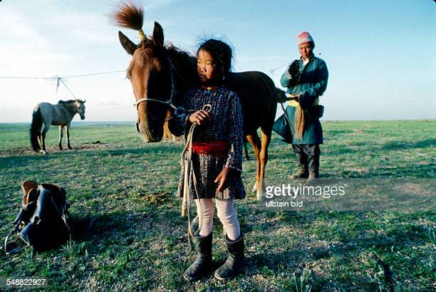 Mongolia, a familys prized possession, a race horse, is being groomed for the Naadam holiday races in the Gobi steppe. Oevoer-Hangay province.