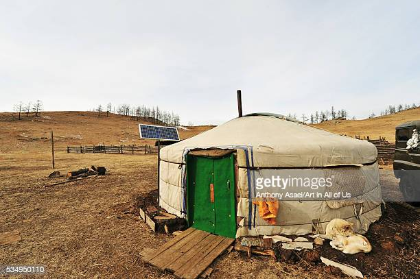 Mongolia Baganuur District Inland rear view of person entering the hut vehicle parked by hut on landscape against sky | Location Baganuur District...