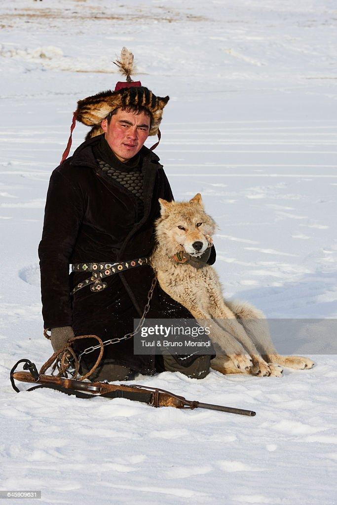 mongolia-bayanolgii-kazakh-and-wolf-picture-id645909631?k=6&m=645909631&s=170667a&w=0&h=uYIP77mwauoAP_xgl_9YyNAIIaDMkg6O8KdgzQqg-1E=