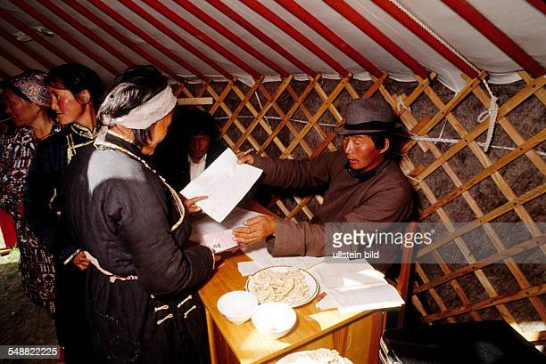 MNG Mongolia election day Nomads giving their vote in a Jurt near the Buddhist monastery Amarbayasgalant