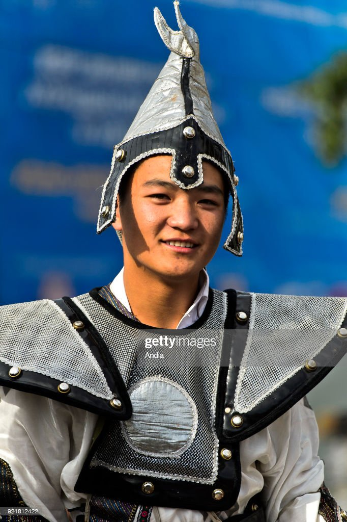 young man wearing a traditional costume on the occasion of the Naadam Festival. Young man wearing a traditional warrior costume.