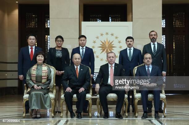 Mongolian Ambassador Bold Radvan and Turkish President Recep Tayyip Erdogan pose for a photo after Mongolian ambassador Radvan presented his letter...