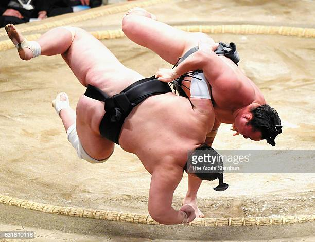 Mongolian Arawashi throws Mongolian ozeki Terunofuji to win during day nine of the Grand Sumo New Year Tournament at Ryogoku Kokugikan on January 16...