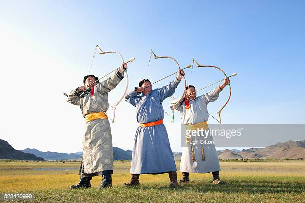 mongolian archers - hugh sitton stock pictures, royalty-free photos & images