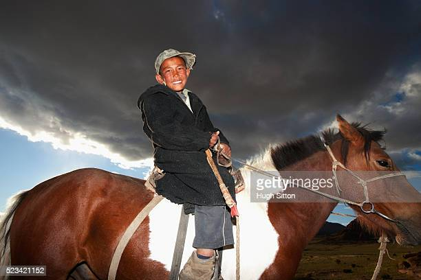mongolian boy riding a horse - hugh sitton stock pictures, royalty-free photos & images