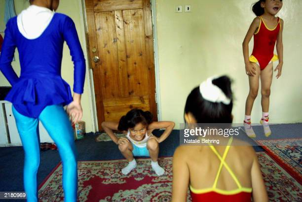 Mongolian children jump to relax their muscles at the end of their daily contortion lesson at the Mongolian State Circus July 18 2003 in Ulan Bator...