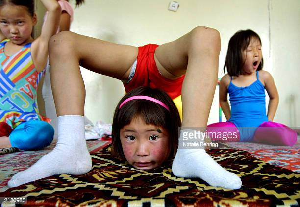 Mongolian children practice contortion during their daily lesson at the Mongolian State Circus July 17 2003 in Ulan Bator Mongolia Flexible children...