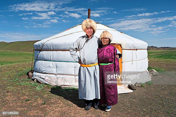 mongolian couple in national clothing next to ger - mongolian women stock photos and pictures