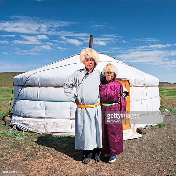 mongolian couple in national clothing - mongolian women stock photos and pictures