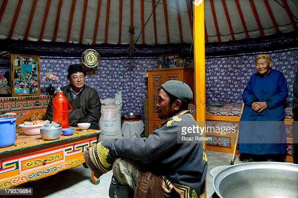 Mongolian family inside their Ger a portable bent woodframed dwelling structure traditionally used by nomads in the steppe in Mongolia