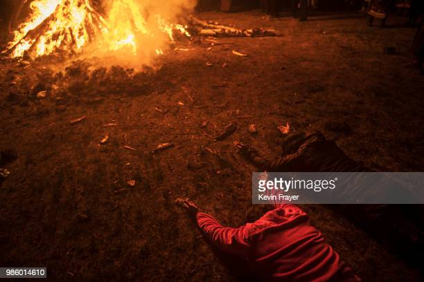 Mongolian followers of Shamanism or Buu Murgul lay on the ground as they pray while taking part in a fire ritual meant to summon spirits to mark the...
