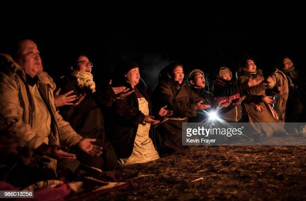 Mongolian followers of Shamanism pray as they take part in a fire ritual meant to summon spirits on April 05 2018 in Sukhbaatar Selenge Province...