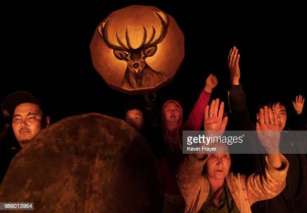 Mongolian followers of Shamanism pray as they take part in a fire ritual meant to summon spirits to mark the period of the Summer Solstice early June...