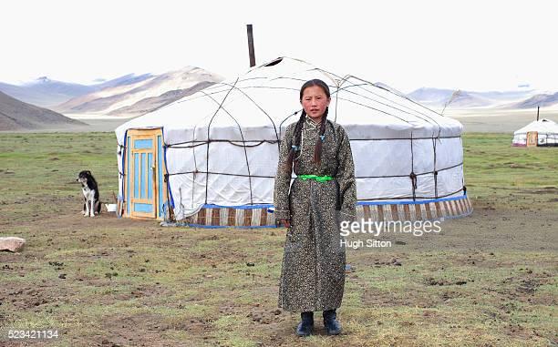 mongolian girl in front of a yurt - hugh sitton stockfoto's en -beelden