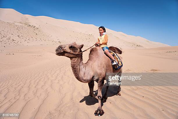Mongolian girl riding on the camel, Gobi Desert