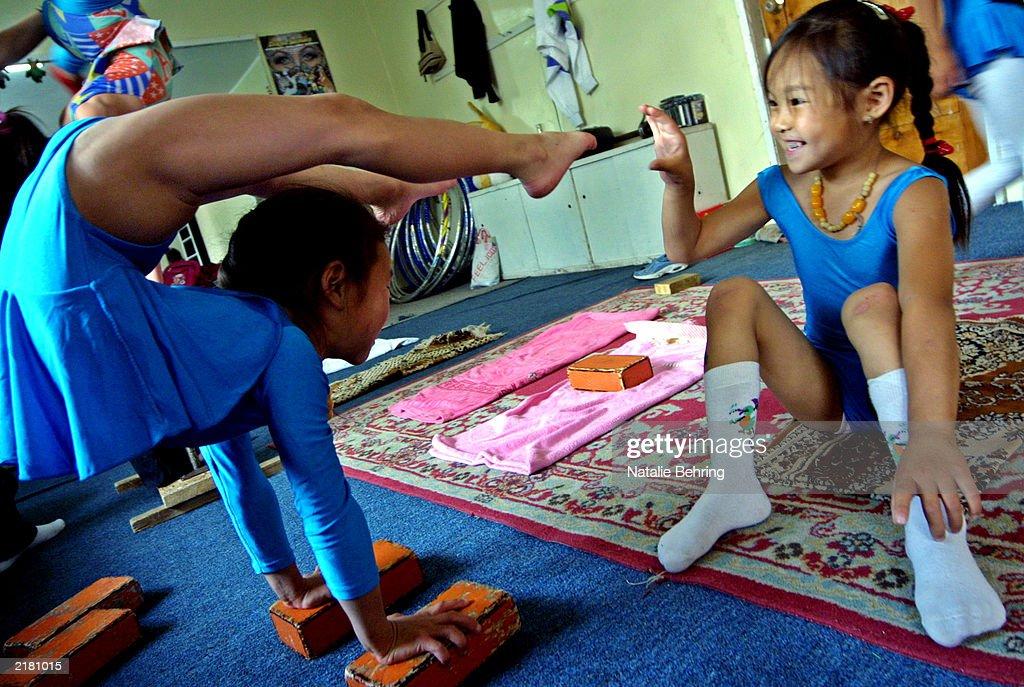 A Mongolian Girl Tickles Her Friend S Foot As She Balances