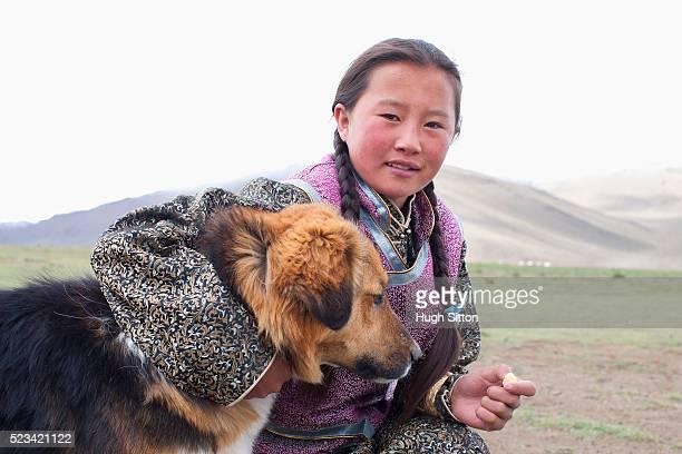 mongolian girl with a dog - hugh sitton imagens e fotografias de stock