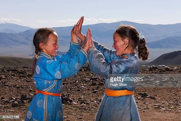 mongolian girls playing - hugh sitton stock-fotos und bilder