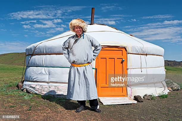 mongolian man in national clothing standing next to ger - independent mongolia stock pictures, royalty-free photos & images
