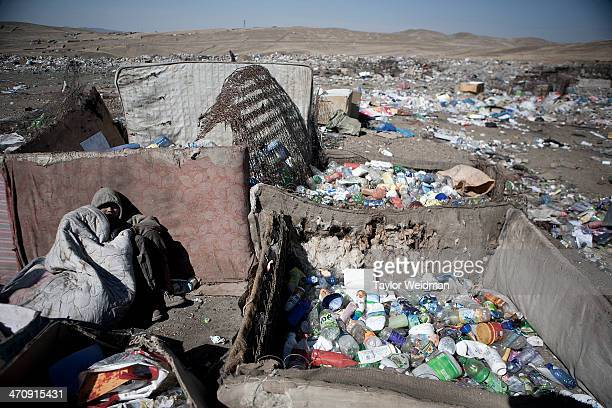 Mongolian man takes a break from sorting trash in a dump in Ulaanbaatar Mongolian pastoral herders make up one of the world's largest remaining...