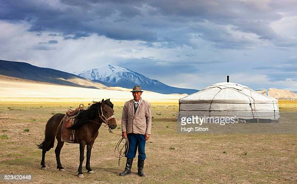 mongolian man with a horse - hugh sitton stock pictures, royalty-free photos & images