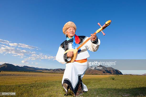 mongolian musician - hugh sitton stock pictures, royalty-free photos & images