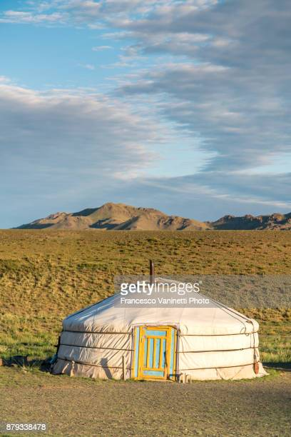 Mongolian nomadic ger and mountains in the background. Bayandalai district, South Gobi province, Mongolia.