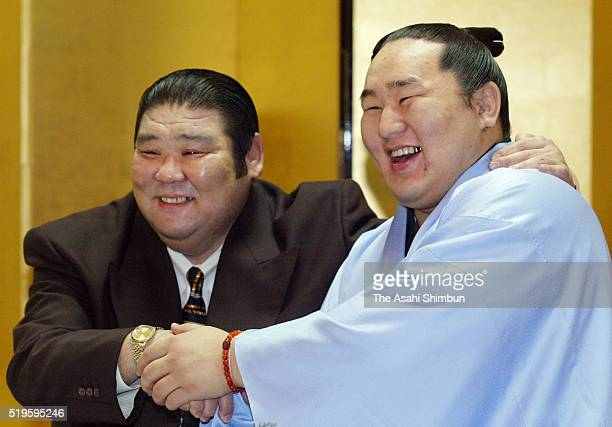 Mongolian ozeki Asashoryu celebrates winning the tournament with his stable master Takasago after day thirteen of the Grand Sumo Kyushu Tournament on...