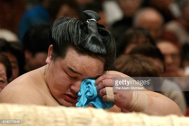 Mongolian ozeki Asashoryu sheds tears with joy after beating Kotomitsuki to win the tournament during day fourteen of the Grand Sumo New Year...
