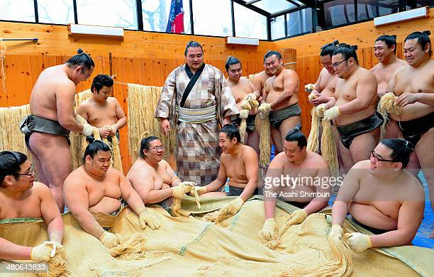 Mongolian ozeki Kakuryu whose real name is Mangaljalavyn Anand watches other sumo wrestler start prepration to make the rope for newly promoted...