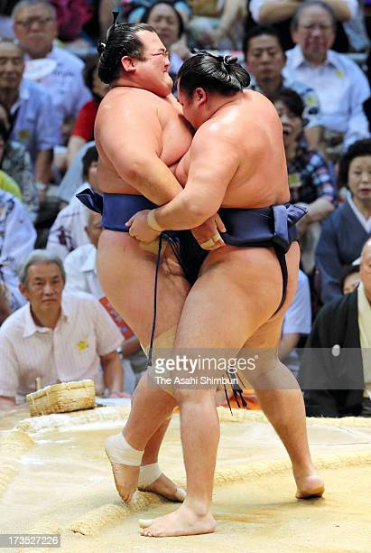 Mongolian ozeki Kakuryu whose real name is Mangaljalavyn Anand pushes out ozeki Kotoshogiku to win during day nine of the Grand Sumo Nagoya...