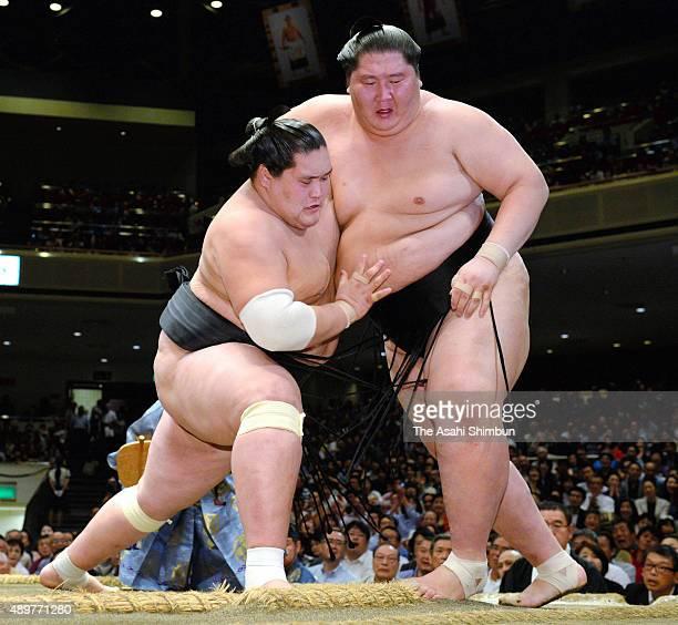 Mongolian ozeki Terunofuji pushes his fellow wrestler Ichinojo out of the ring to win during the Grand Sumo Autumn Tournament at Ryogoku Kokugikan on...