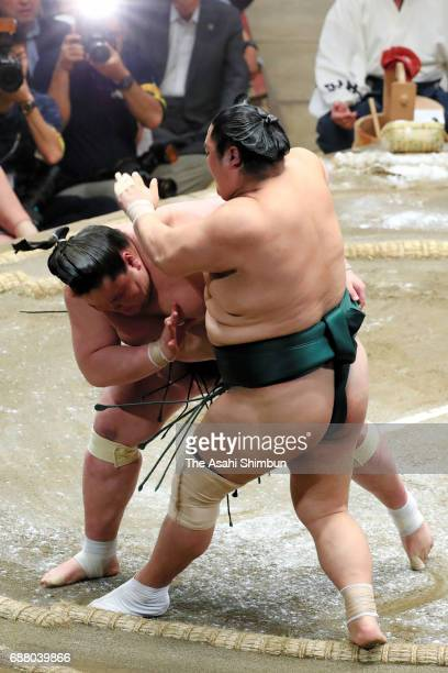Mongolian ozeki Terunofuji pushes Okinoumi out of the ring to win during day seven of the Grand Sumo Summer Tournament at Ryogoku Kokugikan on May 20...