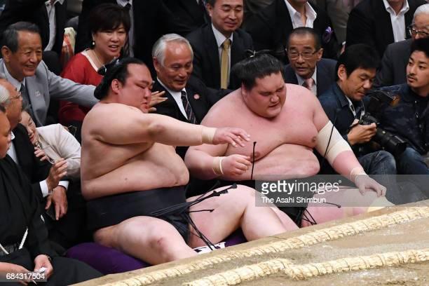 Mongolian Ozeki Terunofuji reacts after his defeat by Mongolian sekiwake Tamawashi during day two of the Grandu Sumo Summer Tournament at Ryogoku...