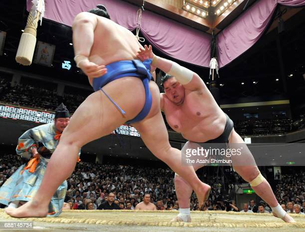 CHINA OUT SOUTH KOREA Mongolian ozeki Terunofuji sends Shodai out of the ring to win during day twelve of the Grand Sumo Summer Tournament at Ryogoku...
