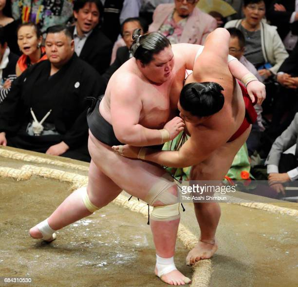 Mongolian ozeki Terunofuji throws Daieisho to win during day three of the Grand Sumo Summer Tournament at Ryogoku Kokugikan on May 16 2017 in Tokyo...