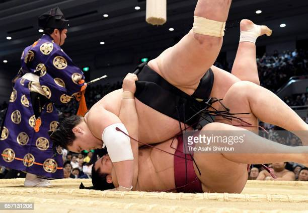 Mongolian ozeki Terunofuji throws Endo to win during day twelve of the Grand Sumo Spring Tournament at Edion Arena Osaka on March 23 2017 in Osaka...