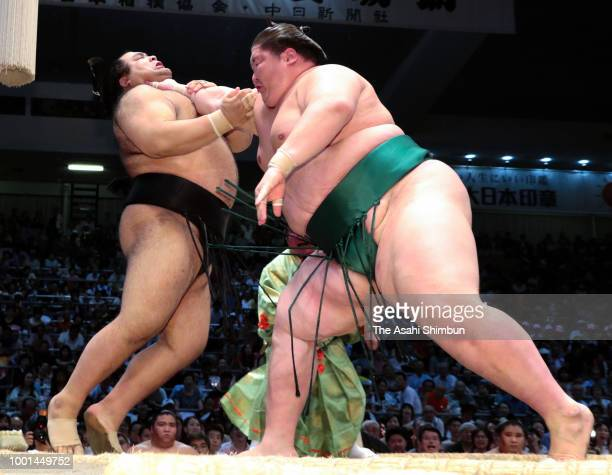 Chiyonoumi pushes Homarefuji out of the ring to win in the juryo rank bout on day eleven of the Grand Sumo Nagoya Tournament at the Dolphin's Arena...
